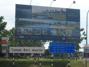 A billboard advertisment along a highway for a new Iskandar housing project